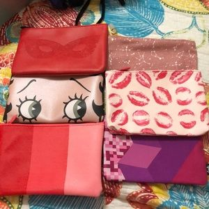 Pack of 6 ipsy bags from various times.
